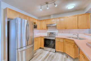 Photo 7: 6 LINCOLN Green SW in Calgary: Lincoln Park Row/Townhouse for sale : MLS®# A1026784