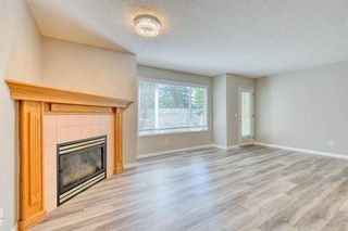 Photo 4: 6 LINCOLN Green SW in Calgary: Lincoln Park Row/Townhouse for sale : MLS®# A1026784