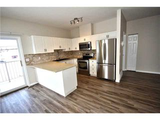 Photo 5: 201 16 POPLAR Avenue: Okotoks Condo for sale : MLS®# C3651941