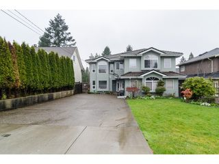 Photo 1: 7961 ROSEWOOD Street in Burnaby: Burnaby Lake House for sale (Burnaby South)  : MLS®# V1112779