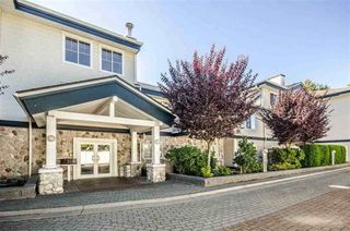 """Photo 1: 205 15298 20 Avenue in Surrey: King George Corridor Condo for sale in """"WATERFORD HOUSE"""" (South Surrey White Rock)  : MLS®# R2264025"""
