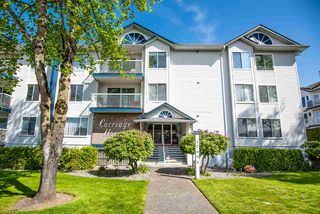 "Photo 1: 212 17695 58 Avenue in Surrey: Cloverdale BC Condo for sale in ""CARRIAGE HOUSE"" (Cloverdale)  : MLS®# R2366333"