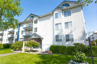 "Photo 2: 212 17695 58 Avenue in Surrey: Cloverdale BC Condo for sale in ""CARRIAGE HOUSE"" (Cloverdale)  : MLS®# R2366333"