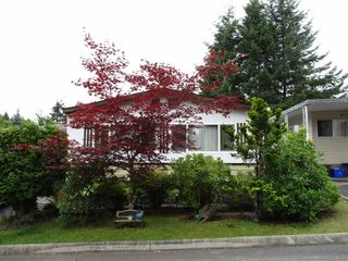 "Photo 1: 52 7850 KING GEORGE Boulevard in Surrey: East Newton Manufactured Home for sale in ""Bear Creek Glen"" : MLS®# R2395015"
