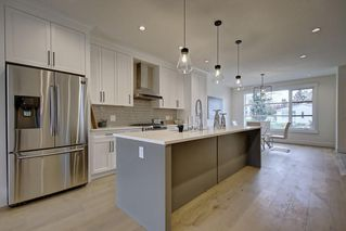 Photo 7: 306 30 Avenue NE in Calgary: Tuxedo Park Semi Detached for sale : MLS®# C4283291