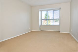 Photo 9: 404 13870 70TH Avenue in Surrey: East Newton Condo for sale : MLS®# F1307583