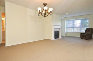 Photo 2: 404 13870 70TH Avenue in Surrey: East Newton Condo for sale : MLS®# F1307583