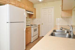 Photo 3: 404 13870 70TH Avenue in Surrey: East Newton Condo for sale : MLS®# F1307583
