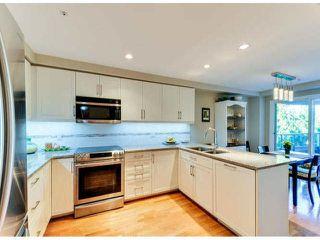 "Photo 4: 405 1725 128TH Street in Surrey: Crescent Bch Ocean Pk. Condo for sale in ""OCEAN PARK GARDENS"" (South Surrey White Rock)  : MLS®# F1427574"
