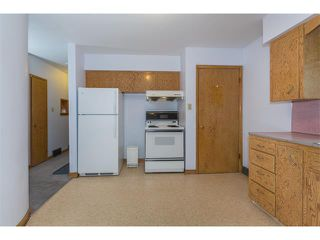 Photo 13: 1011 THORNEYCROFT Drive NW in Calgary: Thorncliffe House for sale : MLS®# C4026935