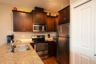 """Photo 7: 413 17712 57A Avenue in Surrey: Cloverdale BC Condo for sale in """"West on the Village Walk"""" (Cloverdale)  : MLS®# R2107869"""