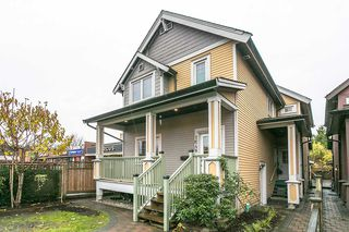 "Photo 1: 1648 E 12TH Avenue in Vancouver: Grandview VE House 1/2 Duplex for sale in ""GRANDVIEW WOODLANDS"" (Vancouver East)  : MLS®# R2222114"