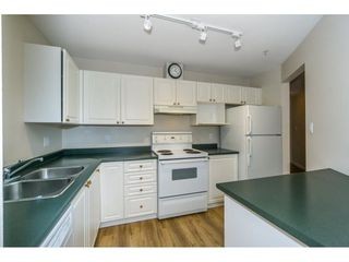 "Photo 4: 424 2551 PARKVIEW Lane in Port Coquitlam: Central Pt Coquitlam Condo for sale in ""THE CRESCENT"" : MLS®# R2228836"