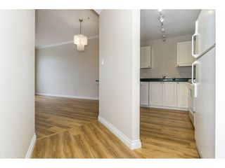 "Photo 3: 424 2551 PARKVIEW Lane in Port Coquitlam: Central Pt Coquitlam Condo for sale in ""THE CRESCENT"" : MLS®# R2228836"