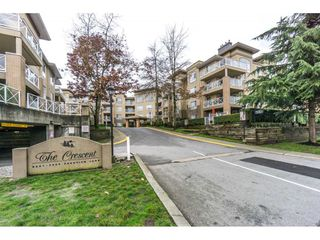 "Photo 1: 424 2551 PARKVIEW Lane in Port Coquitlam: Central Pt Coquitlam Condo for sale in ""THE CRESCENT"" : MLS®# R2228836"