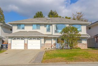 Photo 1: 2479 FRISKIE Avenue in Port Coquitlam: Woodland Acres PQ House for sale : MLS®# R2315278