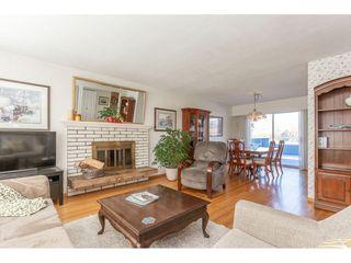 Photo 4: 805 REGAN Avenue in Coquitlam: Coquitlam West House for sale : MLS®# R2340177