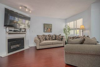 """Photo 2: 306 13900 HYLAND Road in Surrey: East Newton Townhouse for sale in """"Hyland Grove"""" : MLS®# R2485368"""