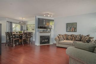 """Photo 4: 306 13900 HYLAND Road in Surrey: East Newton Townhouse for sale in """"Hyland Grove"""" : MLS®# R2485368"""