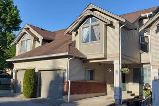 """Photo 1: 306 13900 HYLAND Road in Surrey: East Newton Townhouse for sale in """"Hyland Grove"""" : MLS®# R2485368"""