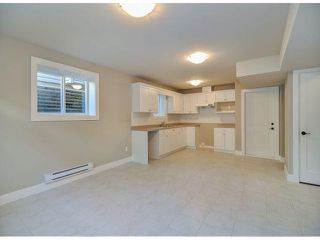"Photo 19: 7695 211B Street in Langley: Willoughby Heights House for sale in ""Yorkson"" : MLS®# F1405712"