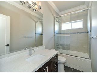 "Photo 17: 7695 211B Street in Langley: Willoughby Heights House for sale in ""Yorkson"" : MLS®# F1405712"