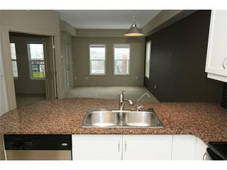 Photo 7: 5501 11811 LAKE FRASER Drive SE in Calgary: Lake Bonavista Condo for sale : MLS®# C4099993