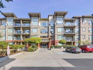 "Photo 1: 414 33538 MARSHALL Road in Abbotsford: Central Abbotsford Condo for sale in ""CROSSING"" : MLS®# R2303349"