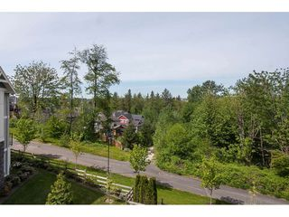 "Photo 12: 11 7198 179 Street in Surrey: Cloverdale BC Townhouse for sale in ""WALNUTRIDGE"" (Cloverdale)  : MLS®# R2366816"