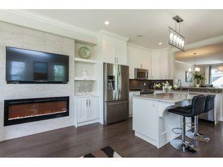 "Photo 7: 11 7198 179 Street in Surrey: Cloverdale BC Townhouse for sale in ""WALNUTRIDGE"" (Cloverdale)  : MLS®# R2366816"