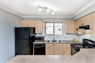 """Photo 2: 2421 244 SHERBROOKE Street in New Westminster: Sapperton Condo for sale in """"COPPERSTONE"""" : MLS®# R2369806"""