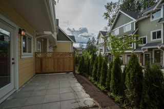 "Photo 1: 304 1405 DAYTON Street in Coquitlam: Burke Mountain Townhouse for sale in ""ERICA"" : MLS®# R2075865"