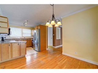 Photo 8: 6415 LONGMOOR Way SW in Calgary: Lakeview House for sale : MLS®# C4102401