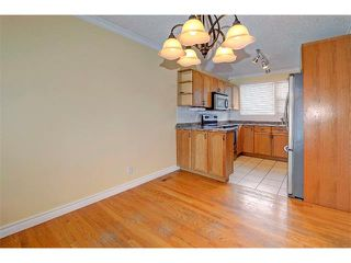 Photo 5: 6415 LONGMOOR Way SW in Calgary: Lakeview House for sale : MLS®# C4102401