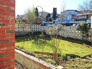 Photo 2: 5566 Chester Street in Vancouver: Fraser VE House for sale (Vancouver East)  : MLS®# V992863