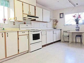 Photo 4: 5566 Chester Street in Vancouver: Fraser VE House for sale (Vancouver East)  : MLS®# V992863