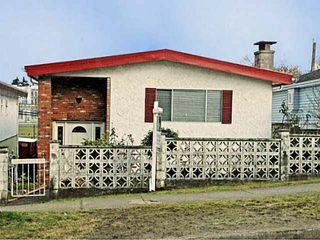 Photo 1: 5566 Chester Street in Vancouver: Fraser VE House for sale (Vancouver East)  : MLS®# V992863