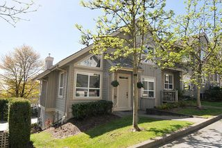 """Photo 1: 310 1465 PARKWAY Boulevard in Coquitlam: Westwood Plateau Townhouse for sale in """"SILVER OAK"""" : MLS®# R2260594"""