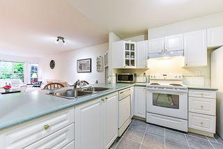 """Photo 2: 107 15110 108 Avenue in Surrey: Guildford Condo for sale in """"River Pointe"""" (North Surrey)  : MLS®# R2395559"""
