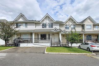 Main Photo: 213 950 ARBOUR LAKE Road NW in Calgary: Arbour Lake Row/Townhouse for sale : MLS®# A1015035