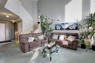 Photo 5: 130 BRIDLEWOOD Way SW in Calgary: Bridlewood Detached for sale : MLS®# A1019777