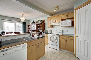 Photo 12: 130 BRIDLEWOOD Way SW in Calgary: Bridlewood Detached for sale : MLS®# A1019777
