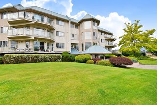 "Photo 1: 306 7685 AMBER Drive in Chilliwack: Sardis West Vedder Rd Condo for sale in ""The Sapphire"" (Sardis)  : MLS®# R2513497"