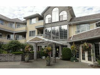 "Photo 1: 128 1653 140TH Street in Surrey: Sunnyside Park Surrey Townhouse for sale in ""Westminster House - Retirement Community"" (South Surrey White Rock)  : MLS®# F1429181"