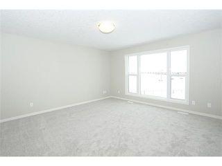 Photo 13: 78 AUBURN SPRINGS Park SE in Calgary: Auburn Bay Residential Detached Single Family for sale : MLS®# C3652537