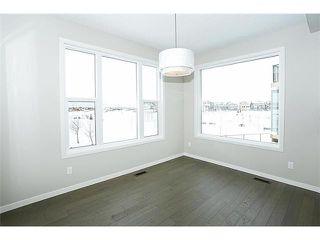 Photo 7: 78 AUBURN SPRINGS Park SE in Calgary: Auburn Bay Residential Detached Single Family for sale : MLS®# C3652537