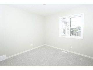 Photo 18: 78 AUBURN SPRINGS Park SE in Calgary: Auburn Bay Residential Detached Single Family for sale : MLS®# C3652537