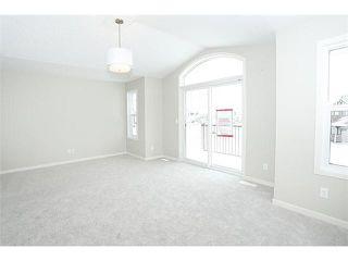 Photo 11: 78 AUBURN SPRINGS Park SE in Calgary: Auburn Bay Residential Detached Single Family for sale : MLS®# C3652537