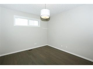 Photo 10: 78 AUBURN SPRINGS Park SE in Calgary: Auburn Bay Residential Detached Single Family for sale : MLS®# C3652537