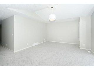 Photo 12: 78 AUBURN SPRINGS Park SE in Calgary: Auburn Bay Residential Detached Single Family for sale : MLS®# C3652537